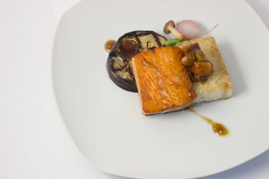Ora-King Salmon, compressed Jasmine Rice Cake, Miso grilled Eggplant, Togarashi vinaigriette